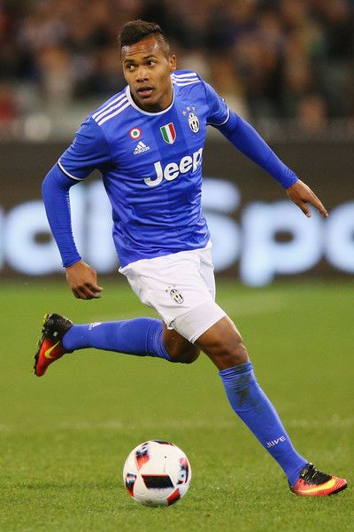 Alex Sandro of Juventus runs with the ball during the 2016 International Champions Cup match between Juventus FC and Tottenham Hotspur at Melbourne Cricket Ground on July 26, 2016 in Melbourne, Australia.