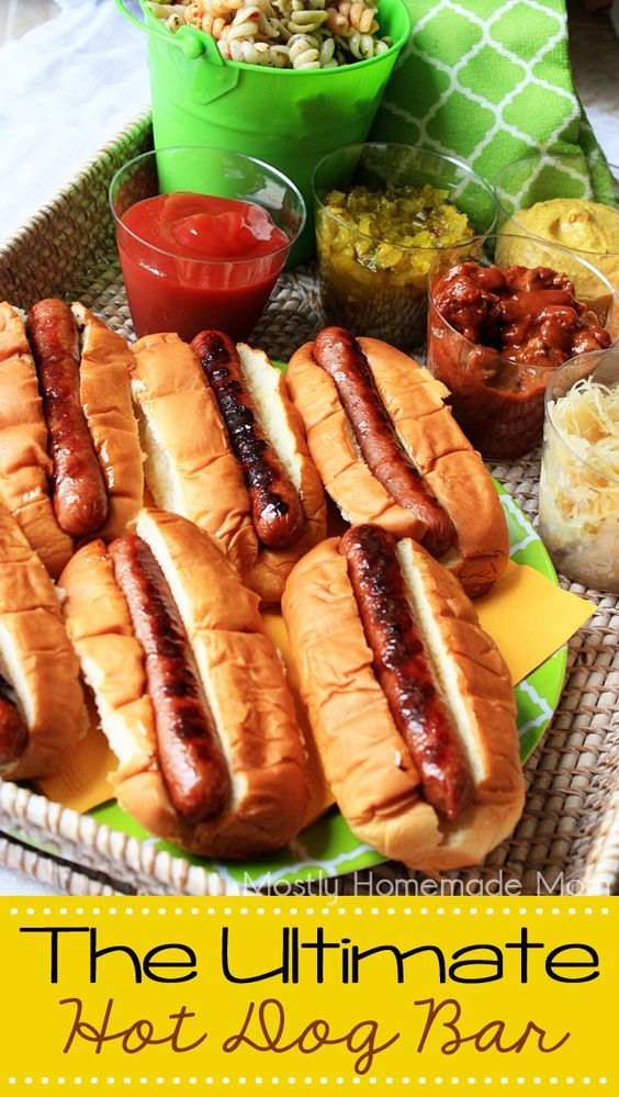 Mostly Homemade Mom | The Ultimate Hot Dog Bar. Summer backyard cookout idea for grilling hot dogs with all the fixings!
