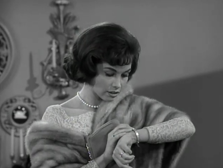 This is dress in the very first episode is stunning! Love that it has long-sleeves.