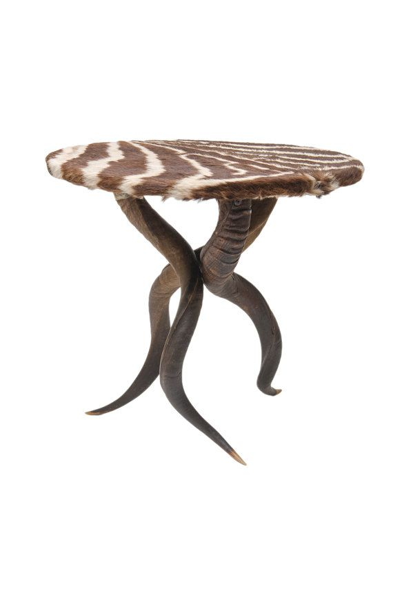 Striking handmade zebra table top on 3 natural kudu horns table  Can be used as a side table or a statement piece.  Sturdy enough for a TV set