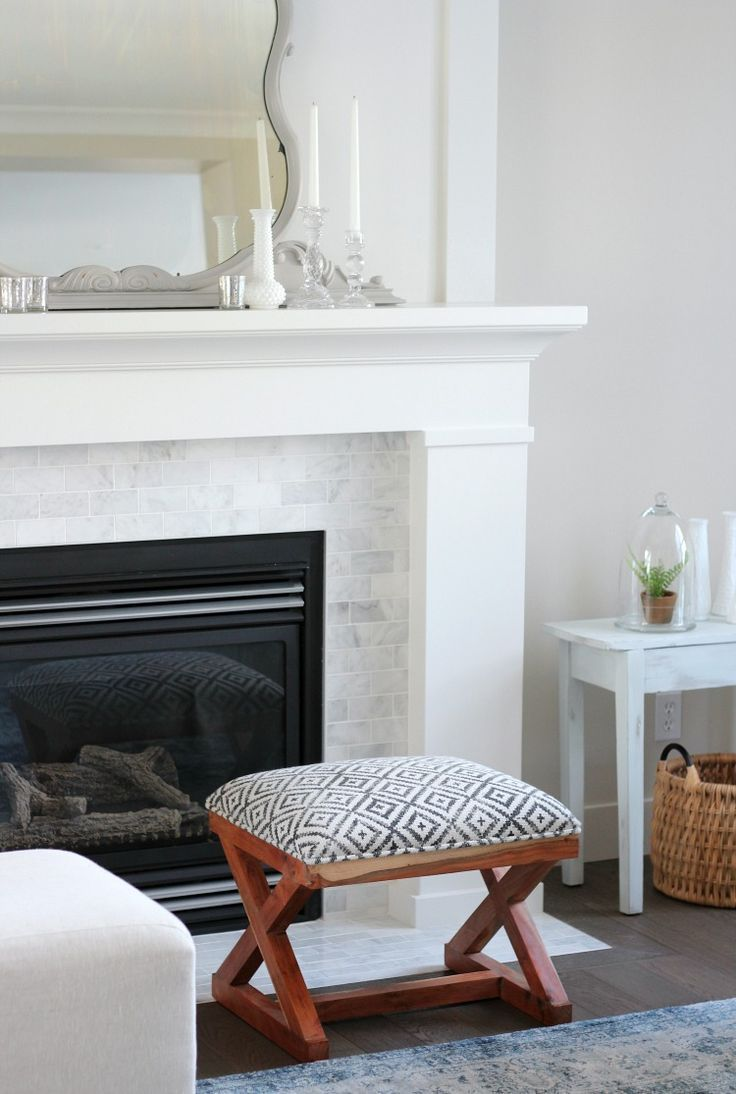 Benjamin Moore White Dove is a beautiful soft white paint colour with a hint of grey making it a popular choice for trim, cabinets, walls and more. Check out some lovely examples and learn how to select the perfect white paint for your space. #whitedove #whitefireplace
