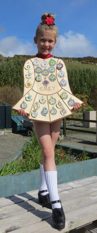 A wooden Irish dancing dress? Love what's been done with our Irish dance medal display! -TouchWood