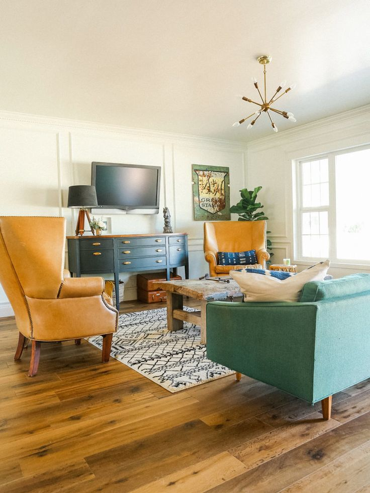 Take a tour through this eclectic home from our friends at Style Me Pretty Living. Warning: this home is filled to the brim with originality and style that may lead to serious envy and mega inspiration like this living room.