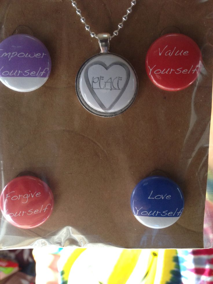1 inch pinback charms showing Life's Missions