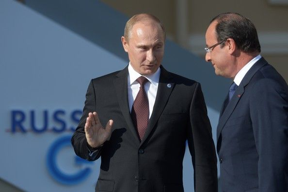 Vladimir Putin Photos Photos - In this handout image provided by Host Photo Agency, Russian President Vladimir Putin (L) stands with French President  Francois Hollande during an official welcome of G20 heads of state and government, heads of invited states and international organizations at the G20 summit on September 5, 2013 in St. Petersburg, Russia.  The G20 summit is expected to be dominated by the issue of military action in Syria while issues surrounding the global economy, including…