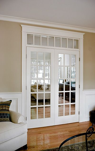 Divide rooms with french pocket doors. Like the transom Windows above the doors too.