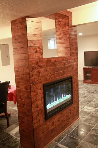 Wood paneling and electric fireplace feature to hide two Hide fireplace ideas