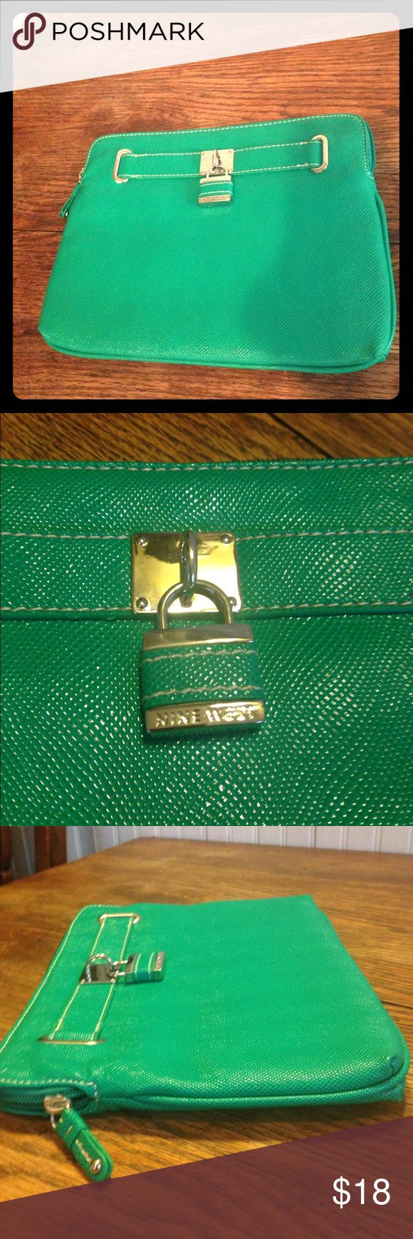 """Nine West green clutch Nine West green clutch , silver tone hardware, fun lock embellishments, zippers no strap or handle, leopard Nine West lining inside, 10.5"""" across, 8"""" high, .75"""" wide, great condition Nine West Bags Clutches & Wristlets"""