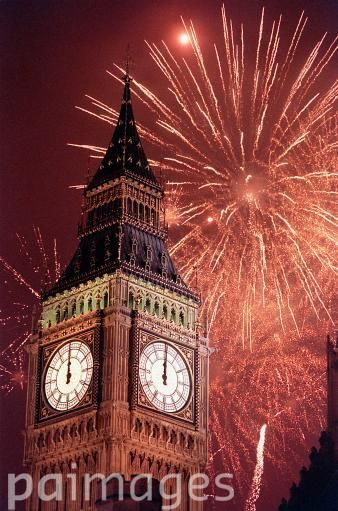 Fireworks explode over Big Ben, at the stroke of midnight, in London, to usher in the new millennium in the United Kingdom.