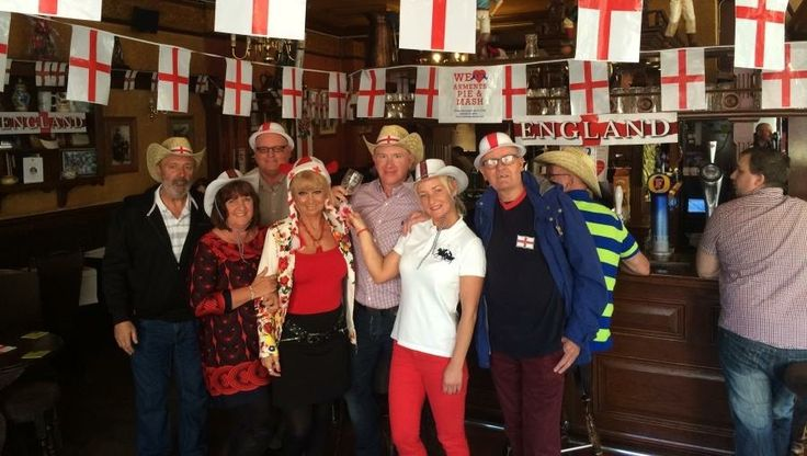 Staff and locals celebrate St Georges Day at the Queen Vic Pub in Southwark Park Road Bermondsey South East London England