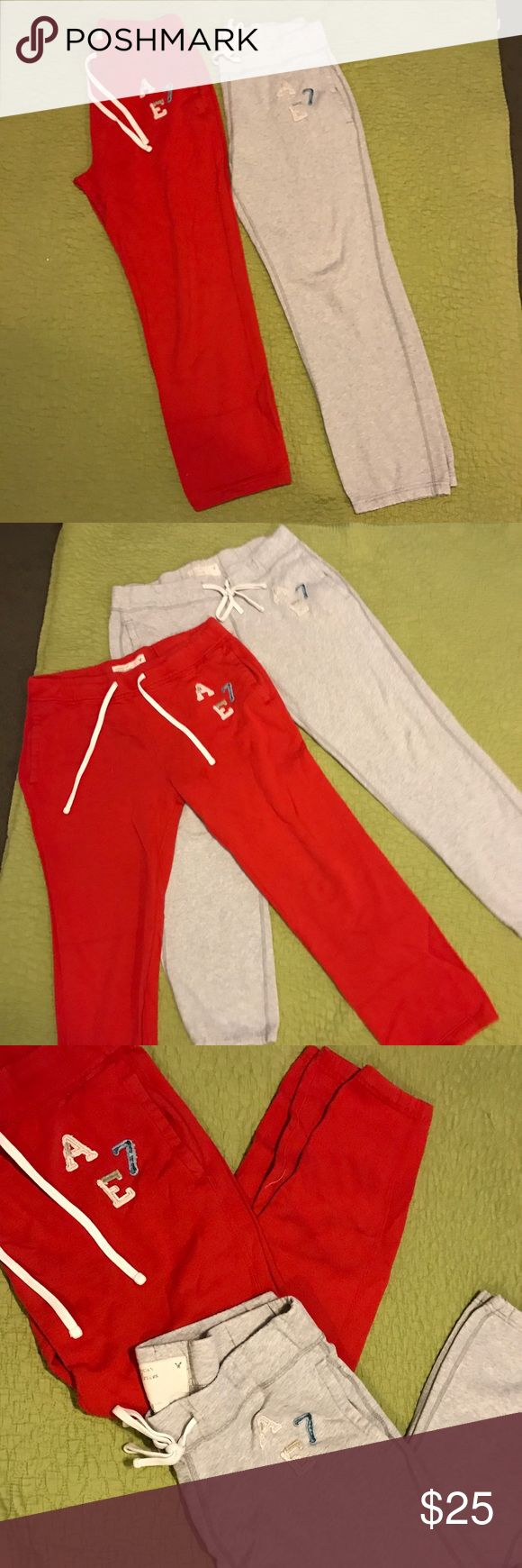 AEO Men's lounge pants Two pairs of American Eagle Men's sweatpants - one in red and one in grey.   Some signs of wear as these are in used condition but, they are super comfortable and great for sleep or loungewear.  They're too small for my husband and too large for me.  I hope someone can use these 💗 American Eagle Outfitters Pants Sweatpants & Joggers