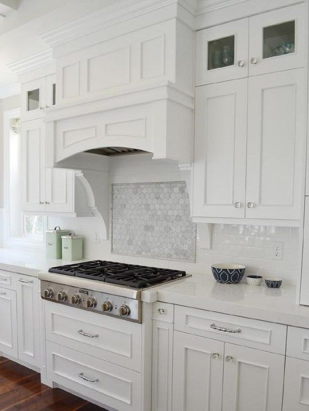Beautiful Kitchen Features White Cabinets Paired With White Quartz  Countertops And A White Subway Tiled Backsplash. Use Dekton White With  Marble Backsplash