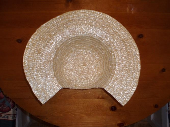 Making a bonnet from a straw hat. Some ideas here, but forget about using a hot glue gun!