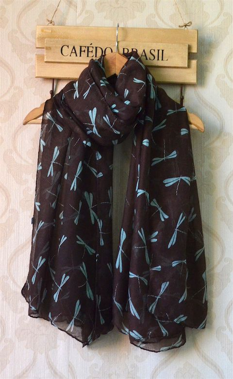 Lovely chocolate brown scarf with small turquoise dragonfly print. Made out of beautiful, lightweight viscose fabric, it's suitable to wear all year round. Great gift idea for any woman – a friend, mother, daughter or girlfriend… or as a treat for yourself too! You can't go wrong with this gorgeous dragonfly print scarf… It's just stunning!
