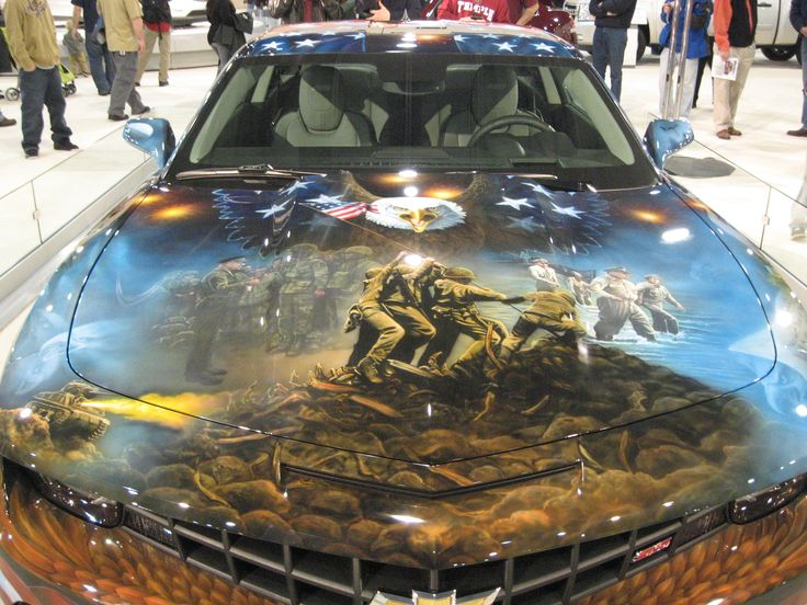 She's a one-of-a-kind Chevrolet Camaro, comissioned by General Motors as a tribute to our nation and to the brave men and women who have sacrificed so much for it.    It was painted 100% freehand by Mickey Harris.