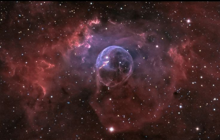 Blown by the wind from a massive star, this interstellar apparition has a surprisingly familiar shape. Cataloged as NGC 7635, it is also known simply as The Bubble Nebula. Although it looks delicate, the 10 light-year diameter bubble offers evidence of violent processes at work.