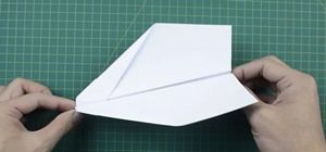 Origami is an art form, but origami using dollar bills? It takes this art form to a whole new level! In this three-part video tutorial, learn how to fold an F-18 Hornet fighter jet plane out of a dollar bill, origami-style. To download a PDF diagram for this project click here. UPDATED VIDEO INSTRUCTIONS: Video: . PREVIOUS INSTRUCTIONS (3 Parts): Video: . Video: . Video: .