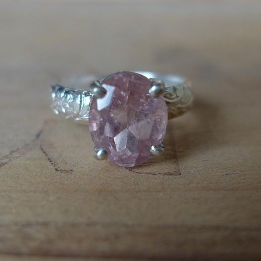 This beautiful genuine pink tourmaline is prong set on a textured floral band. The stone has lots of inclusions that make it truly unique! #cocktailring #octoberbirthstone #silver #handmade #reclaimed #slashpiledesigns #blush #pink