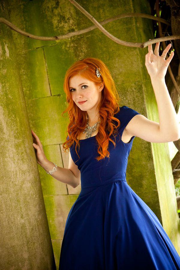 Redhead in a royal blue wedding gown.  Stunning!