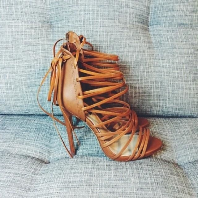 These need to be in my closet immediately! Very sexy lace up heeled sandals. Easy to pair with any outfit.
