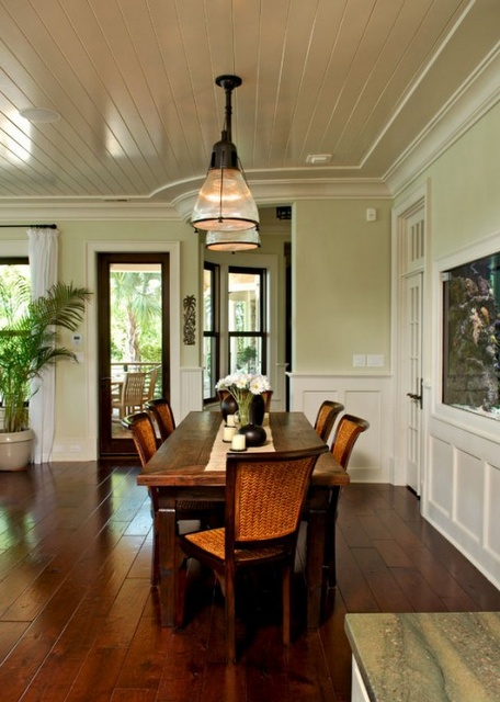 Light green walls bead board ceilings dark wood tables for Light green dining room