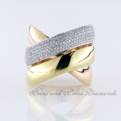 There is a total carat weight of 0.85ct round brilliant cut diamonds pavé set on an 18k white gold band with an 18k yellow and rose gold crossover 3 row band design