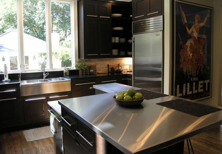 How To Make The Most Of Stainless Steel Backsplashes. Yes, I am still considering stainless steel counter tops. Maybe there's a way to make them look softer.