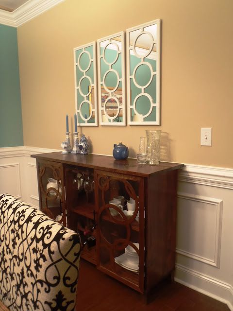 For the empty wall above my dining buffet, I made three small wall mirror.    The mirror made the room seem larger.    After building the ch...