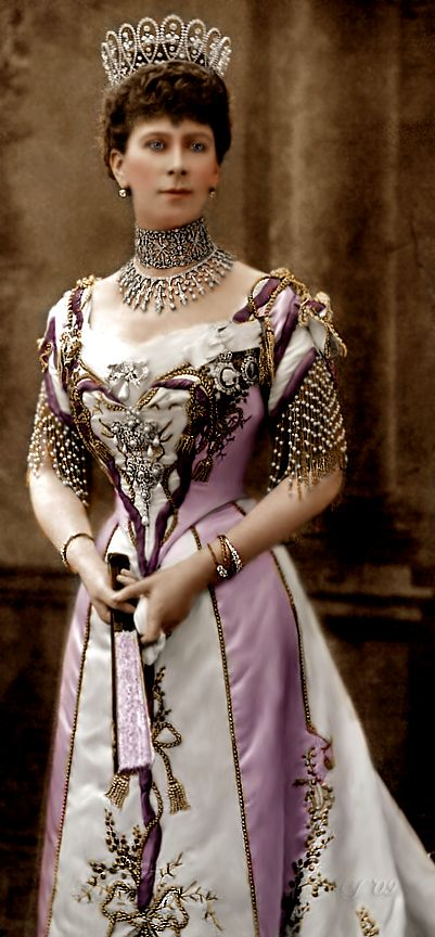 Queen Mary of Teck, wife of King George V and the grandmother of Queen Elizabeth II. Her mother was a member of the British royal family, and her father was a German duke.