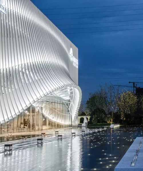 lacime architects cover exhibition hall with undulating façade in suzhou, china