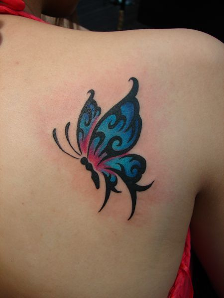 Blue Butterfly on Back Tattoo