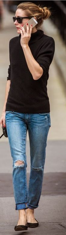 Olivia Palermo in Rebecca Minkoff blue ripped jeans and Italia Independent black sunglasses