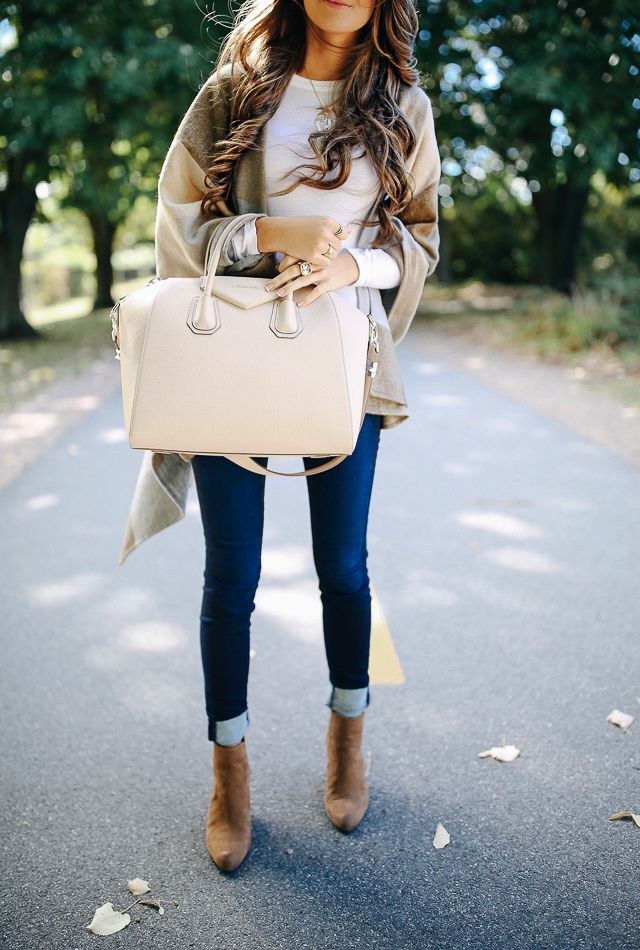 Poncho, skinny jeans, booties.