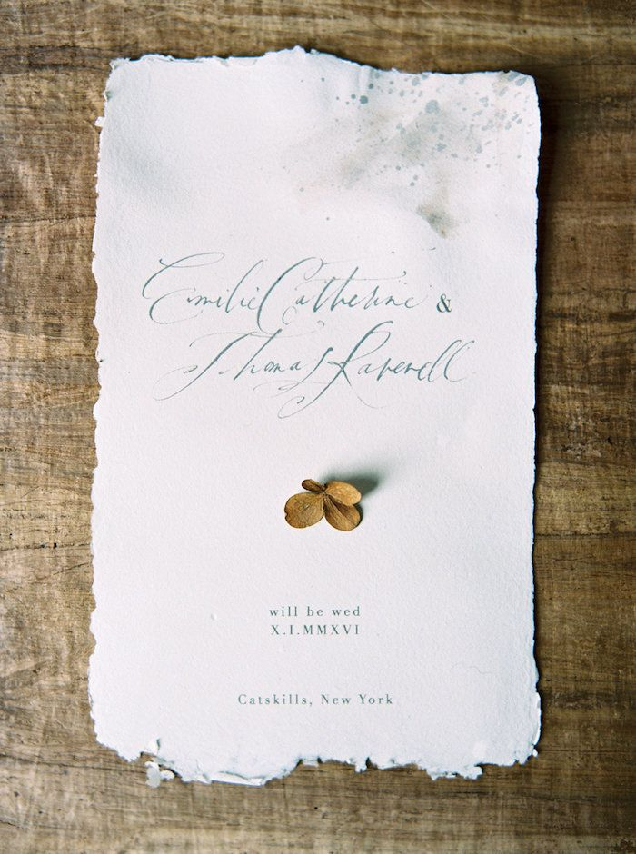 simple wedding announcement on handmade paper with calligraphy.