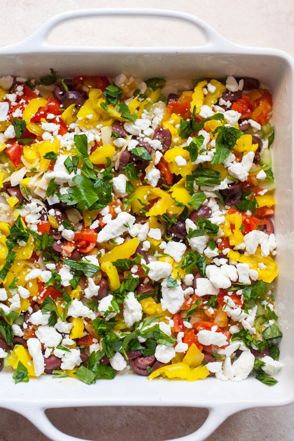 10 Layer Greek Dip / hummus, greek yogurt, green bell pepper, cucumber, grape tomatoes, kalamata olives, artichoke hearts, banana peppers, feta cheese, parsley