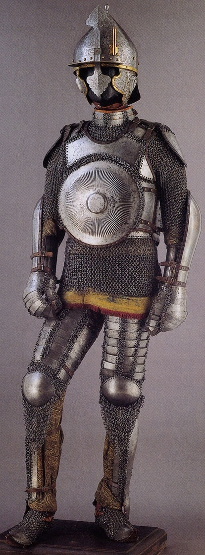 Armor of the Ottoman Empire. A complete suit of 16th century armor as worn by fully armored cavalryman (sipahi) including Chichak (helmet), krug (chest armor), zirah (mail shirt), kolluk/bazu band (vambrace/arm guards), dizcek (cuisse or knee and thigh armor), and kolçak (greaves or shin armor).  Stibbert Museum, Florence Italy.