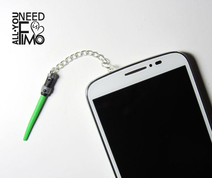 Charm for smartphones with fimo laser sword from Star Wars!   INFO: https://www.facebook.com/AllYouNeedIsFimo/photos/a.937250929688782.1073741828.932013750212500/1068415666572307/?type=3&theater  #fimo #polymerclay #artigianato #fattoamano #handmade #accessori #accessories #smartphone #cellphone #stopper #tappi #antipolvere #antidust #dustproofplug #jack #earphones #plugs #starwars #jedi #green #lasersword #spadalaser #etsy #etsyfinds #allyouneedisfimo #charm #nerd #geek