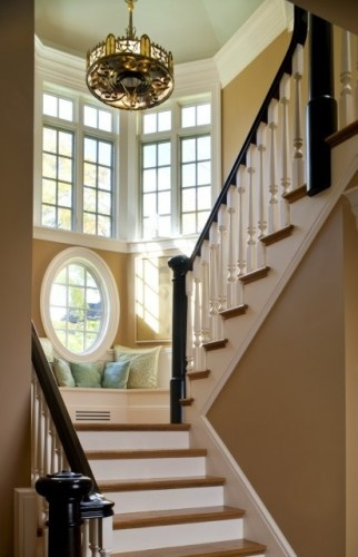 The nook needs to be wider with more cushions, but I love the circular window and chandelier, the colors, and the high ceiling!: Ideas, Dreams Houses, Round Window, Stairs, Staircase, Reading Nooks, Windows, Oval Window, Window Seats
