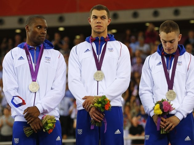 France's silver medallists Gregory Bauge (L), Michael D'Almeida and Kevin Sireau (C) stand on the podium during the victory ceremony after the track cycling men's team sprint finals at the Velodrome during the London 2012 Olympic Games August 2, 2012. REUTERS/Cathal McNaughton (BRITAIN - Tags: OLYMPICS SPORT CYCLING)