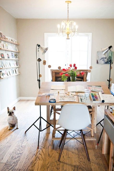 home studio office,  I like the idea of a tiltable table and the wall to display what you're working on or have finished.