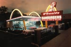 This is McDonald's, It opened in  the company began in 1940 as a barbecue restaurant operated by Richard and Maurice McDonald. In 1948, they reorganized their business as a hamburger stand using production line principles. Businessman Ray Kroc joined the company as a franchise agent in 1955. He subsequently purchased the chain from the McDonald brothers and oversaw its worldwide growth. Why is it important, because Franny starts to eat this when she goes to her dads airbase.