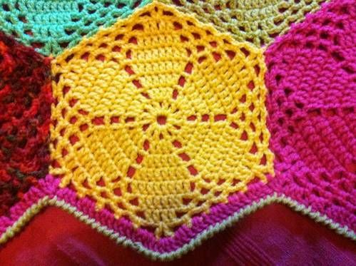 crochet hexagon motif...edging is just dc for one round then crab stitch to finish { The motif for the blanket is the simple hexagon from the encyclopaedia of crochet techniques, by Jan Eaton.}