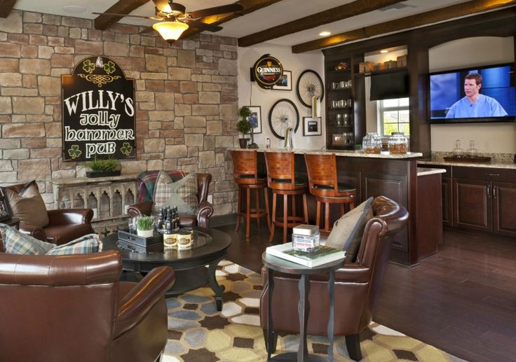 Awesome man cave with bar and sitting area. #mancaves #basements homechanneltv.com