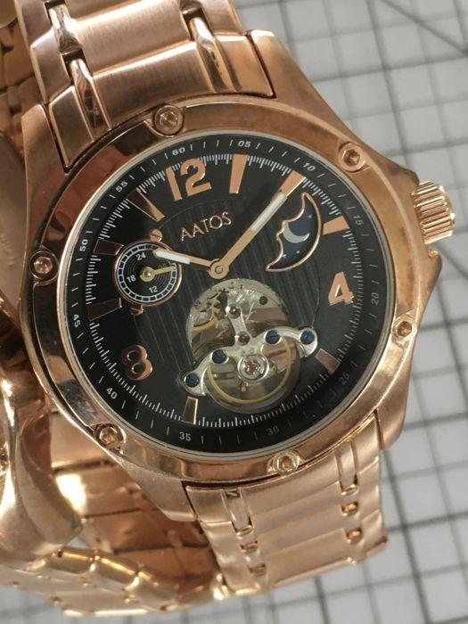 """Ihmissusi """"Moonphase Dual Time"""" - mannen horloge - 2017--gebruikt mint conditie.  Ihmissusi Moonphase Dual time automatischeMade in GermanyRoestvrij staal41.1mm diameterDikte 122 mmGewicht 147 gr.Ihmissusi rose gouden roestvrij stalen armband 17-22cm verstelbaar gebrandmerkt heeft een opvouwbare gesp met extra veiligheid.Heeft twee sub wijzerplaten voor de maan-fase en de uren.Rose gouden handen en rose gouden cijfers en knuppels op een middernacht zwarte wijzerplaat en een venster om 6 uur…"""