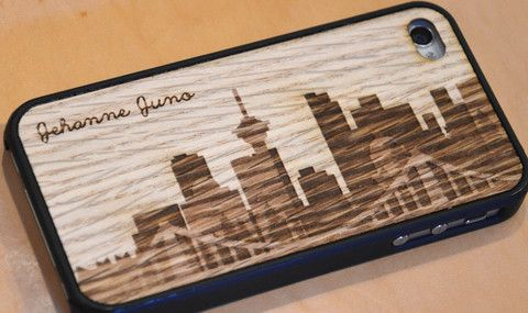 Laser engrave a wooden iPhone case with anything. This one is Make Vancouver's original Vancouver skyline graphic, personalized with a name.