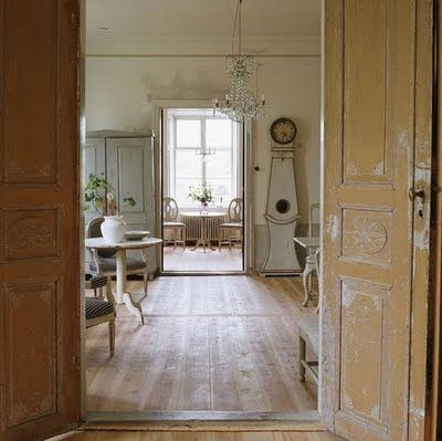 Gustavian style is marked by grayed pastels, lots of whites and creams, painted furniture, clean simple lines, and fabulous lighting.