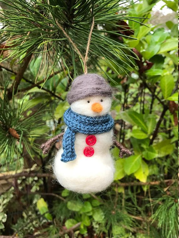 Meet our little needle felted snowman Christmas tree decoration! This little snowman was made out of Merino Wool using the dry needle felting process. He stands at approximately 12cm tall and comes with a loop made of twine, ready to hang on your Christmas tree. He comes with his