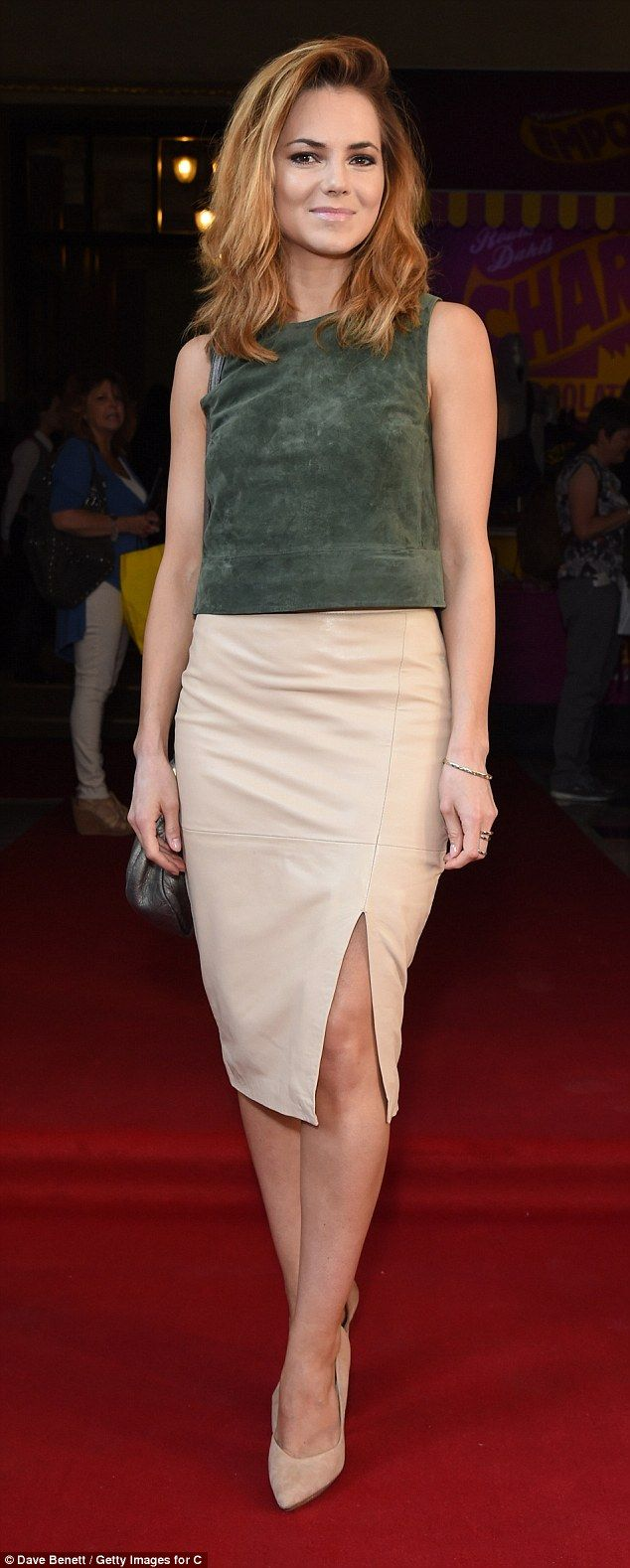 Her golden ticket: Kara Tointon showed off her enviable legs at a special Charlie and the ...