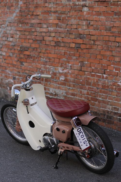 Honda Cub with maroon quilted seat