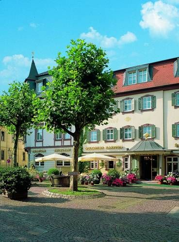 Romantik Hotel Goldener Karpfen Fulda Located in Fulda, 48 km from Bad Kissingen, Romantik Hotel Goldener Karpfen boasts a restaurant, bar and free WiFi throughout the property. Guests can enjoy the on-site restaurant. Free private parking is available on site.